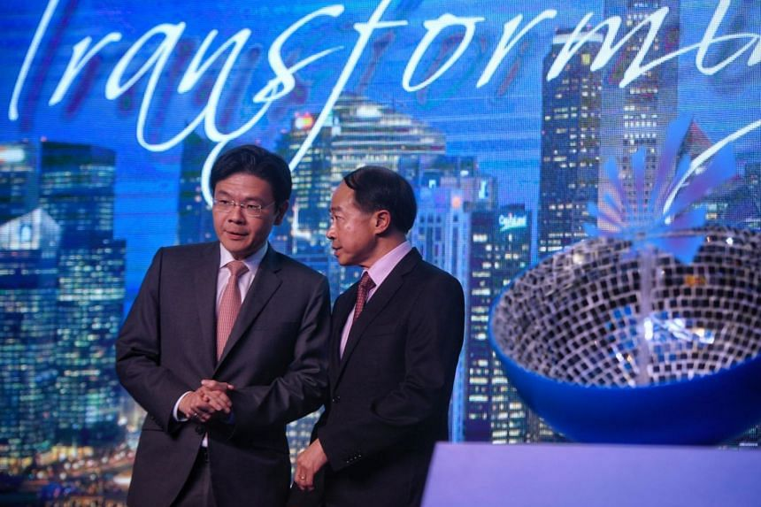 Minister of National Development Lawrence Wong (left) and REDAS President Augustine Tan on stage after the inaugural launch of the URA-REDAS Spark Challenge on Nov 14, 2017.