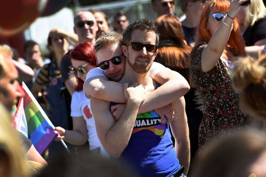 """Supporters of the same-sex marriage """"Yes"""" vote gather to celebrate the announcement in a Sydney park on Nov 15, 2017."""