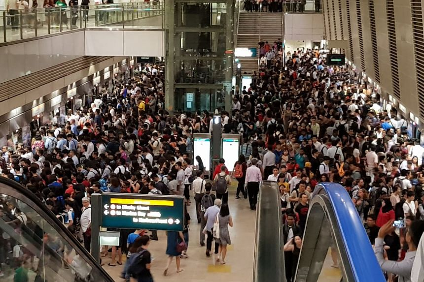 Crowds line up to get on the trains at Bishan MRT station.