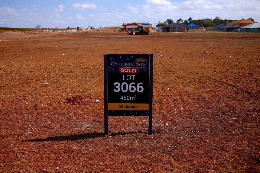 A real estate sign with a sold sticker is seen on a property at a housing development in the western Sydney suburb of Oran Park in Australia.