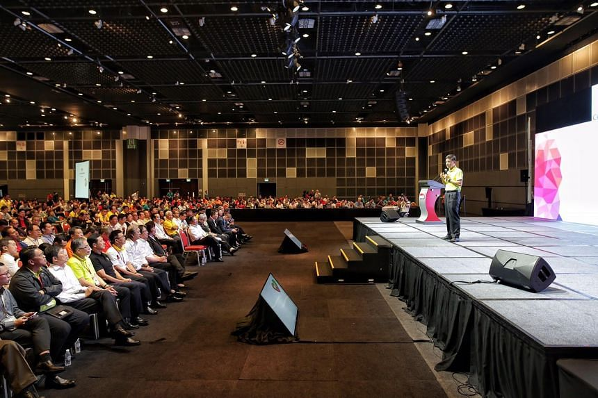 NTUC secretary-general Chan Chun Sing addressing some 1000 unionists, company officials and government officials at a dialogue with ministers on Nov 15, 2017.