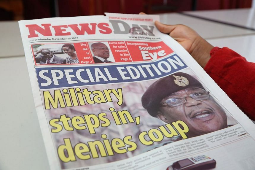 A woman reads a copy of the special edition of a local daily in Harare, Zimbabwe, Nov 15, 2017.