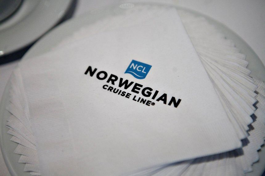 A Norwegian Cruise Line logo appears on a napkin aboard the Norwegian Epic ship.