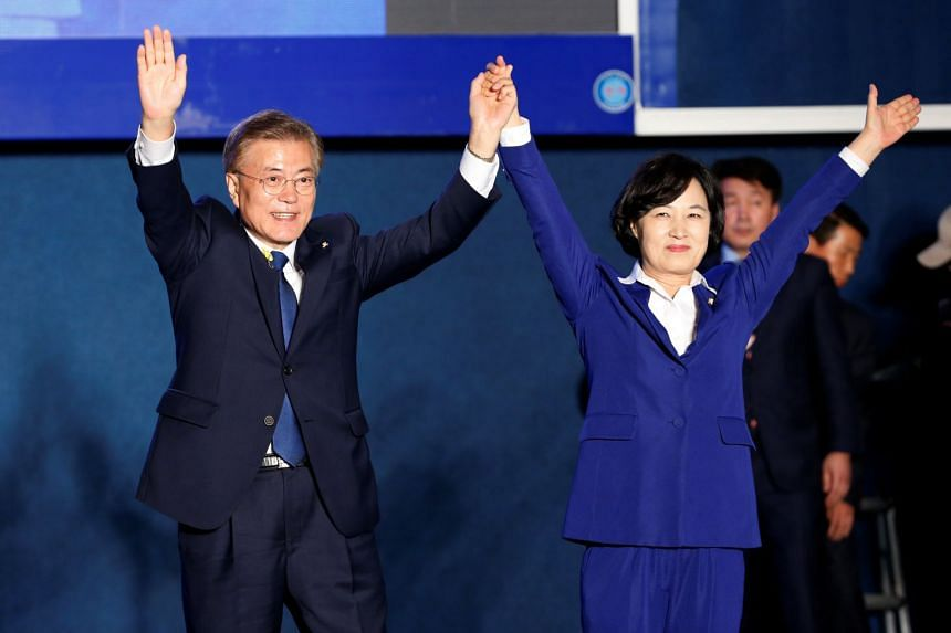 Choo Mi-ae (right) pictured after the party's win in South Korea's election in May 2017, with South Korean President Moon Jae-in.