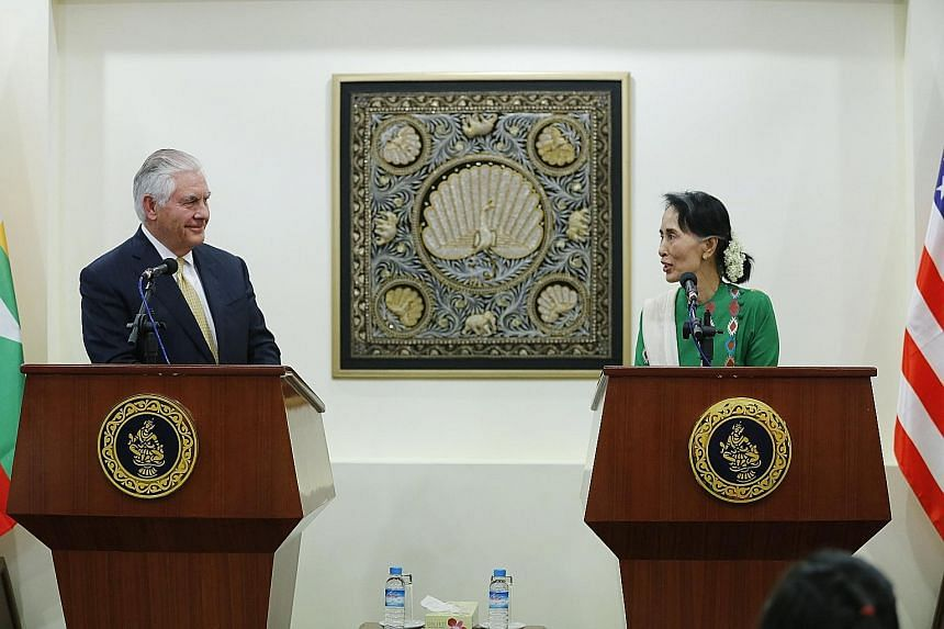 """US Secretary of State Rex Tillerson and Myanmar State Counsellor Aung San Suu Kyi at a joint press conference after their meeting in Naypyitaw yesterday. Mr Tillerson said: """"We want to see Myanmar succeed. You can't just impose sanctions and say, the"""