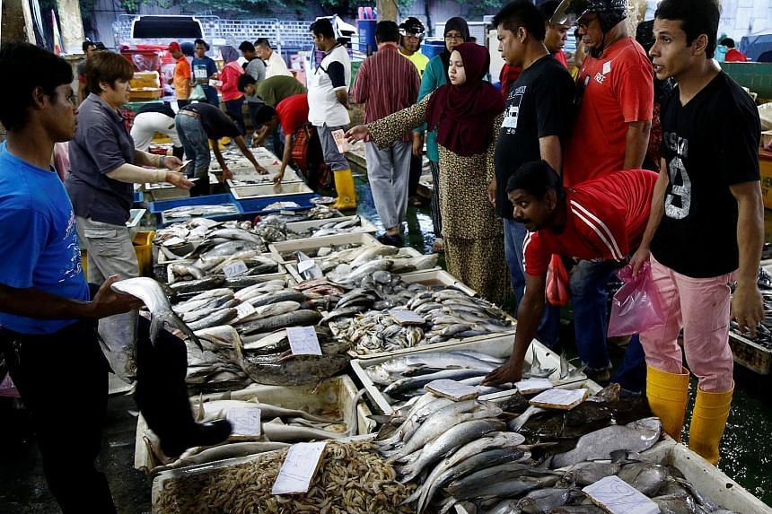 Customers selecting seafood at a wet market in Klang, outside Kuala Lumpur, on Oct 27. Ms Jeanne Khor, secretary of the Pantai Remis Fishermen Association, said the rainy season could cut the catch by 50 to 60 per cent.