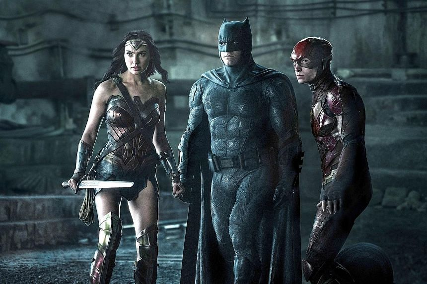 (From left) Gal Gadot, Ben Affleck and Ezra Miller star in Justice League.