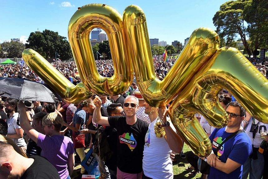 Supporters of same-sex marriage celebrating the results of the national vote in a Sydney park yesterday.The 61.6 per cent vote in favour of marriage equality marks a watershed moment for gay rights in Australia, where it was illegal in some states to