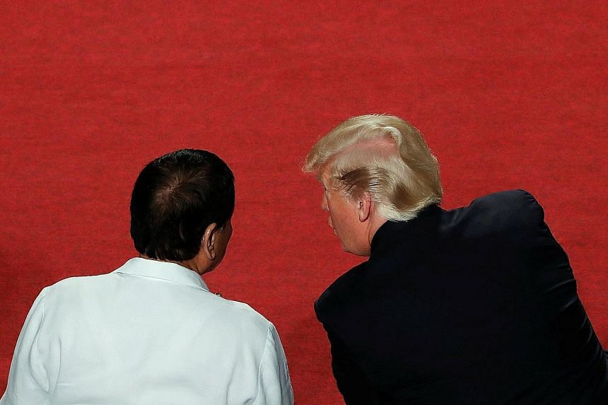 US President Donald Trump and his Philippine counterpart, Mr Rodrigo Duterte, at the opening ceremony of the Asean Summit in Manila on Monday.