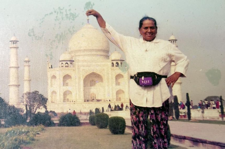 Madam Mary's late father, Mr Charles Richard Paul, with her niece Audry Pereira in 1972. Madam Mary standing in front of the Taj Mahal during a family holiday to India in 1996. After the Japanese Occupation, she forged a career in acting and singing.