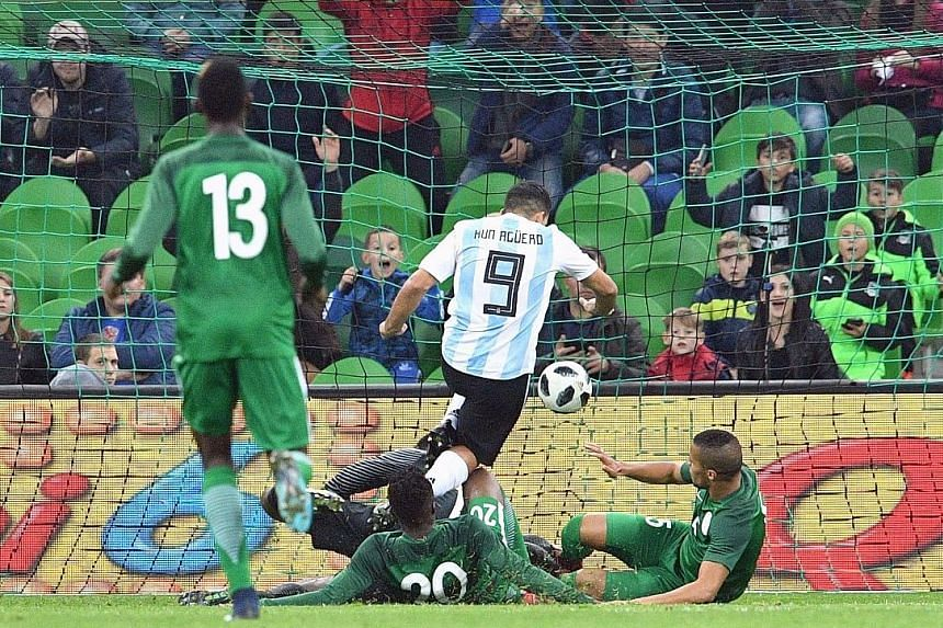 Argentina's Sergio Aguero evading the attentions of the Nigerian defence to bundle home his side's second goal during their international friendly. Argentina lost the striker and their composure in the second half, as they threw away their lead to ca
