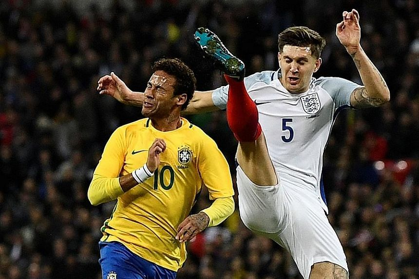 England's John Stones putting in a high but fair last-ditch challenge to deny Brazil's Neymar a clear run at goal. The Brazilian showed glimpses of his wizardry with the ball at Wembley, but ultimately could not break down a defence well-marshalled b