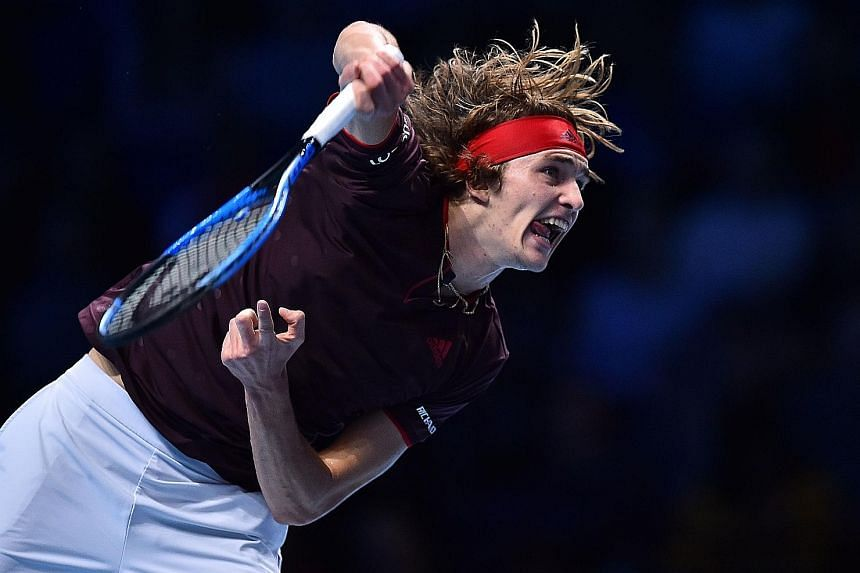 Germany's Alexander Zverev returning against Swiss Roger Federer during their ATP Finals round-robin match on Tuesday. The world No. 3, despite his defeat, can still reach the semi-finals on Saturday if he can get past American Jack Sock today.