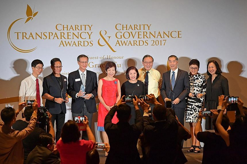 At the awards ceremony last night were (from left) Commissioner of Charities Ang Hak Seng, Touch Community Services' Pastor Lawrence Khong, Care Corner Singapore's Mr Benjamin Ong, Minister for Culture, Community and Youth Grace Fu, Gardens by the Ba