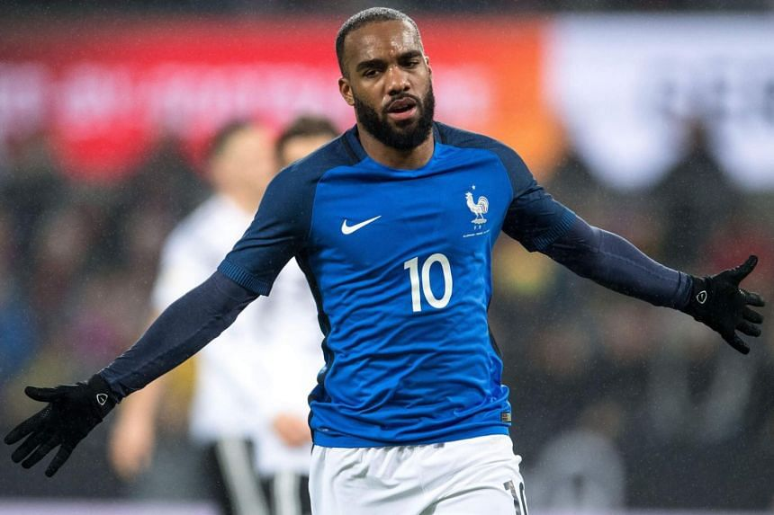 France's forward Alexandre Lacazette celebrates scoring the 1-2 during the international friendly football match Germany against France in Cologne on Nov 14, 2017.