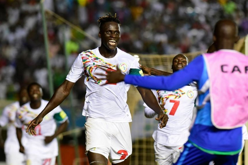 Senegal's players celebrate after winning the FIFA 2018 World Cup Africa Group D qualifying football match between South Africa and Senegal at Leopold Cedar Senghor Stadium in Dakar on Nov 14, 2017.