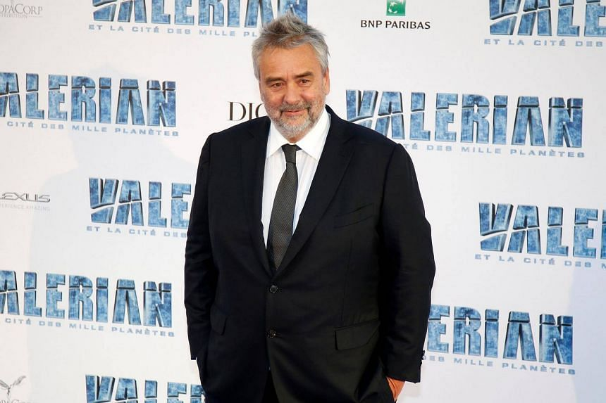 Director Luc Besson poses as he arrives for the premiere of his film Valerian and the City of a Thousand Planets in Saint-Denis, France.