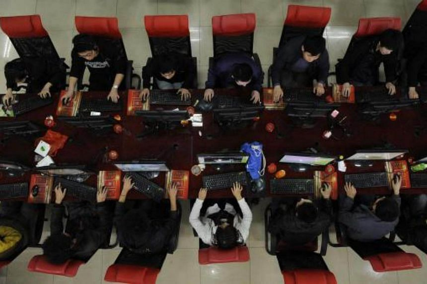 People use the computer at an Internet cafe in Taiyuan, China.