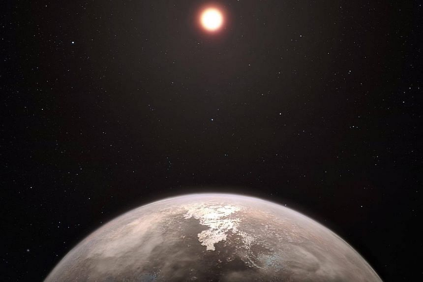 An artist's impression of a newly discovered planet and its red dwarf star, Ross 128.