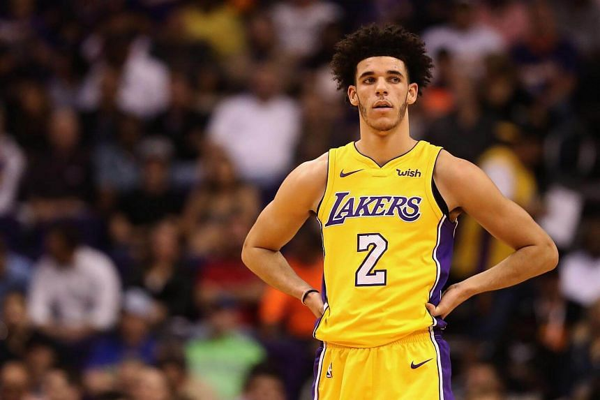 Lonzo Ball of the Los Angeles Lakers reacts on the court during the first half of the NBA game against the Phoenix Suns at Talking Stick Resort Arena in Phoenix, Arizona on Nov 13, 2017.