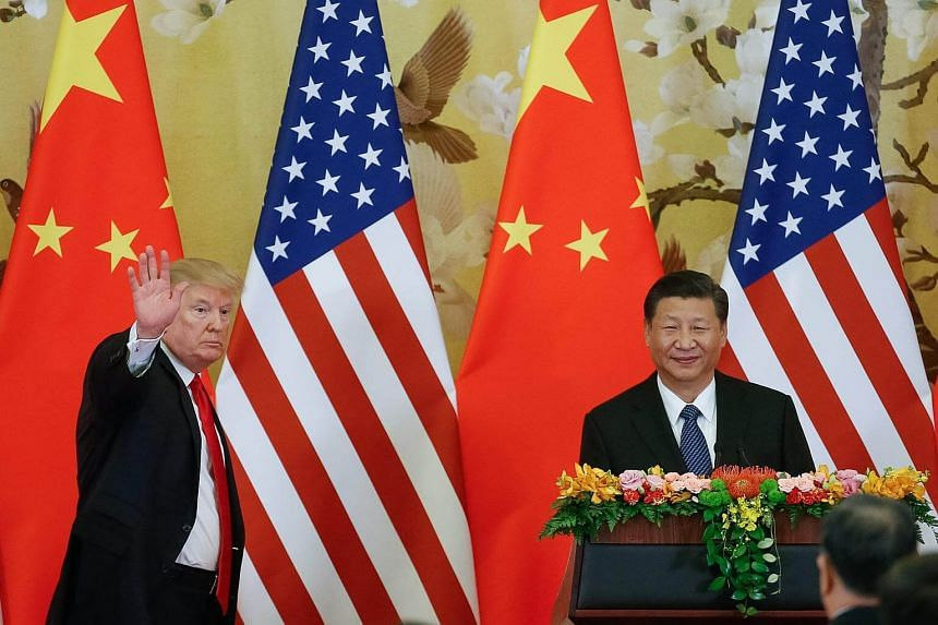 US President Donald Trump and China's President Xi Jinping make joint statements at the Great Hall of the People in Beijing, China.