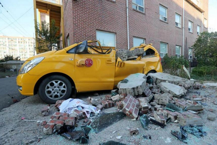 A damaged vehicle and debris caused by an earthquake are seen in Pohang, South Korea, on Nov 15, 2017.