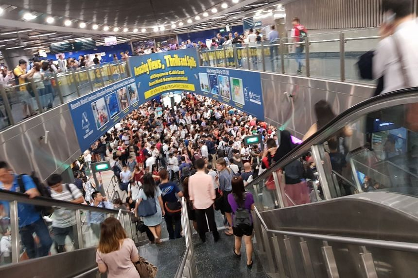 Commuters at HarbourFront station affected by the North East Line delay on Thursday evening (Nov 16). PHOTO: CHERMAINE NG