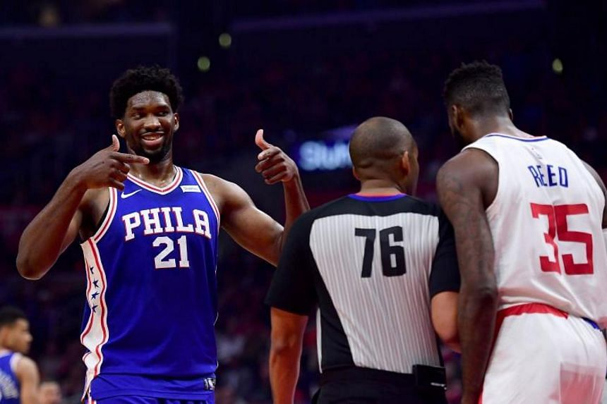 Joel Embiid of the Philadelphia 76ers reacts to Willie Reed of the LA Clippers during a 109-105 76er win at Staples Center on Nov 13, 2017.