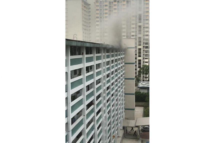 Smoke coming from a 10th-storey unit at Block 32, Holland Close on Nov 2, 2017.