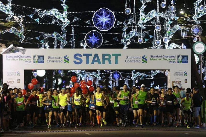 Participants being flagged off at Orchard Road at the start of the Standard Chartered Marathon Singapore on Dec 4, 2016.