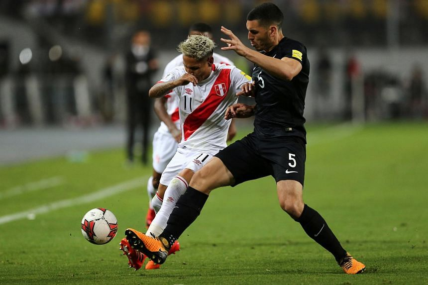 Peru's Raul Ruidiaz and New Zealand's Michael Boxall at the 2018 World Cup Qualifying Playoffs in Lima, Peru on Nov 15, 2017.