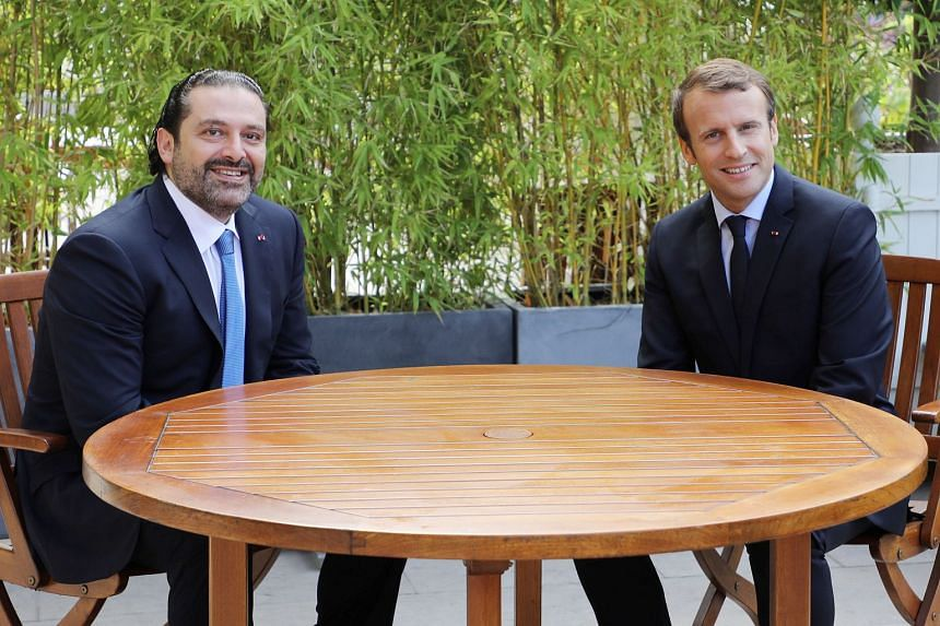 Macron (right) and Hariri on the terrace of the Elysee Palace in Paris on Sept 1, 2017.
