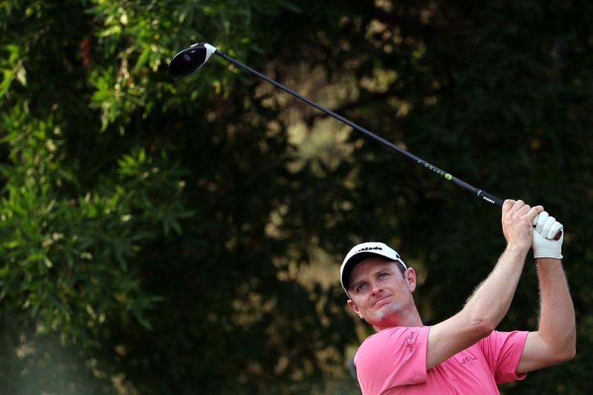 England's Justin Rose plays a shot during the first round of the DP World Tour Championship.