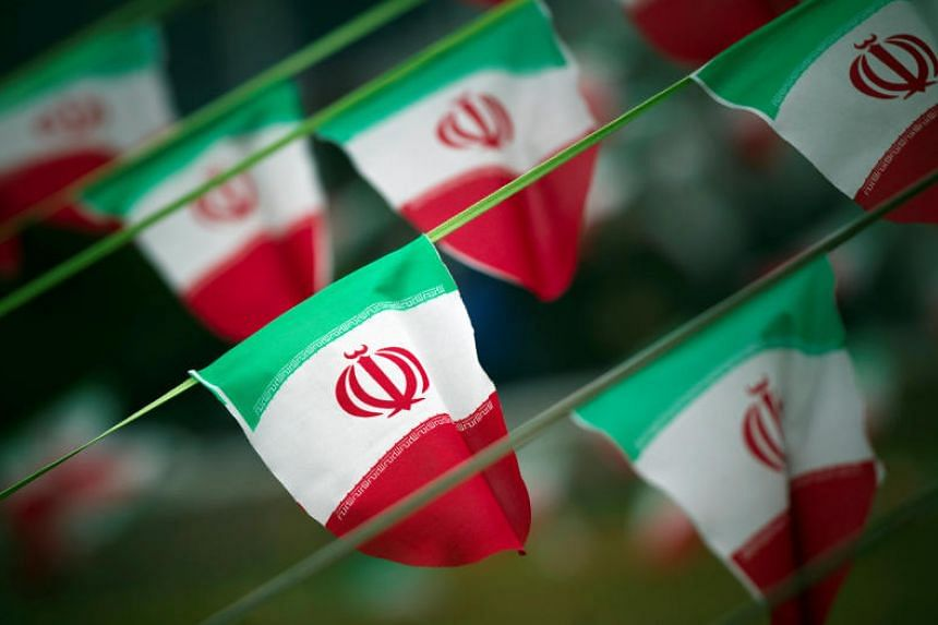 Iran's national flags are seen on a square in Teheran on Feb 10, 2012.