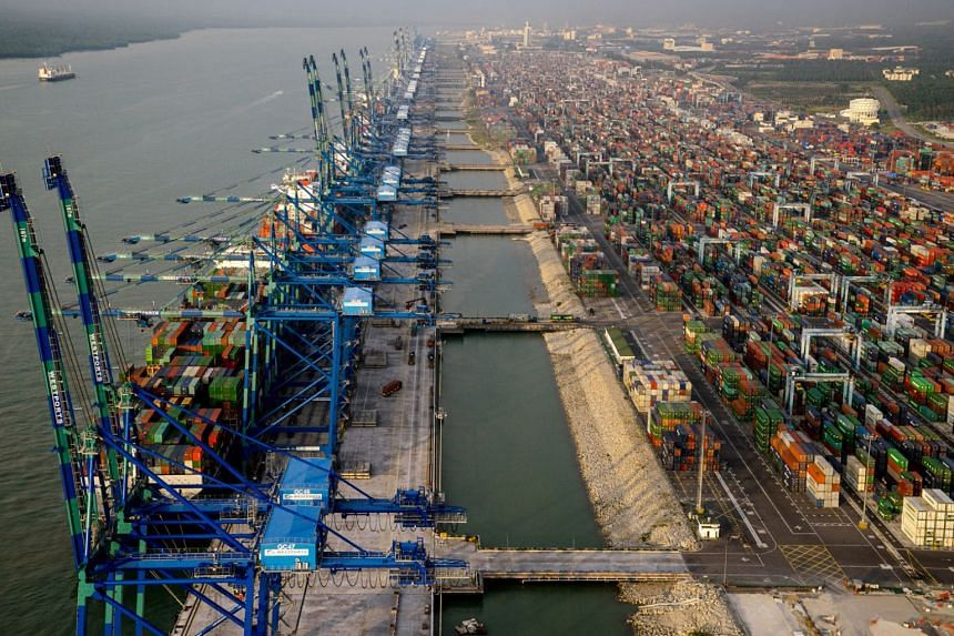 Container ships sit docked next to gantry cranes at Port Klang in Selangor, Malaysia on Jan 9, 2016. The Carey Island project, together with Port Klang nearby, was originally meant to challenge Singapore's dominant position as South-east Asia's marit