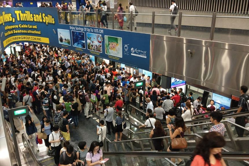 Crowds at HarbourFront station, after a train fault at Clarke Quay caused a disruption on the North East Line on Nov 16, 2017.