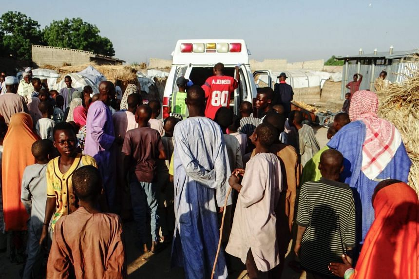 An ambulance carries the dead away from the scene of a previous suicide blast in Maiduguri in October 2017.