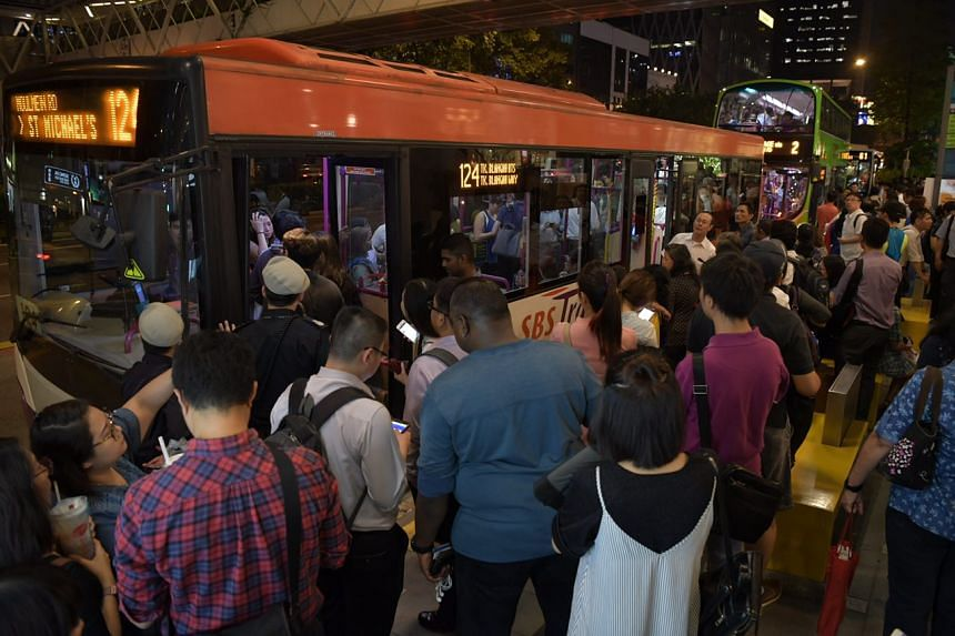 People waiting at the bus stop outside Clark Quay MRT station at 8pm on Nov 16, 2017.