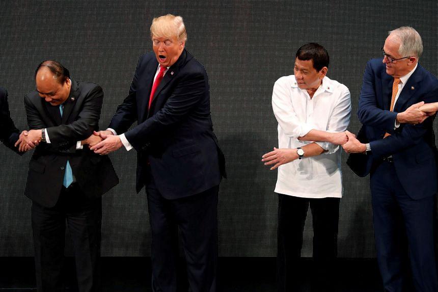 Mr Donald Trump clasping Vietnamese Prime Minister Nguyen Xuan Phuc's hand, but breaking the handshake line with Philippine President Rodrigo Duterte and Australian Prime Minister Malcolm Turnbull.