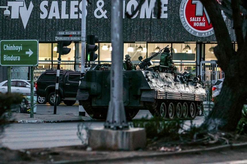 A Zimbabwean army armoured personnel carrier is parked at an intersection in Harare, Zimbabwe.
