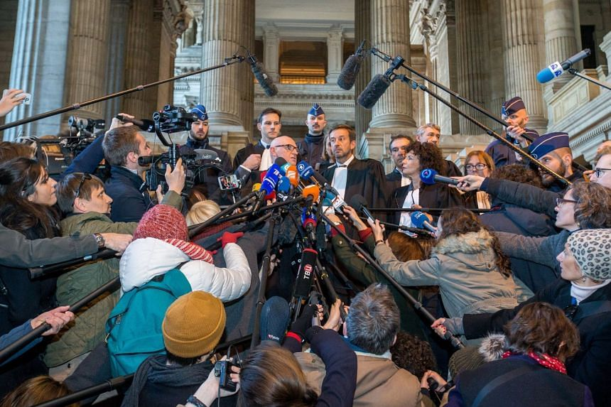 Journalists reach for quotes from lawyers Paul Bekaert (centre left) and Christophe Marchand (centre right).