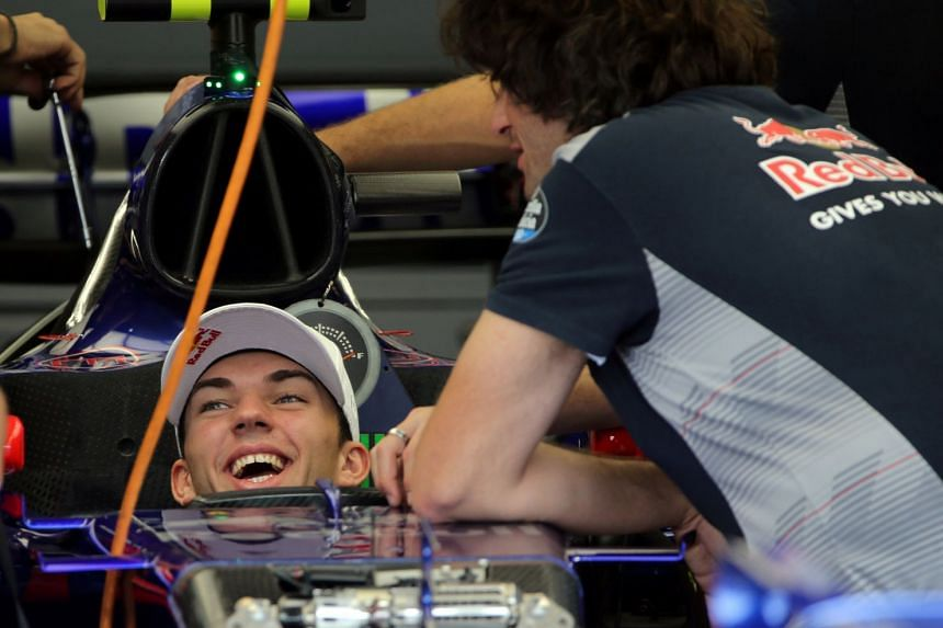 Toro Rosso driver Pierre Gasly in his car in the team garage at the Interlagos circuit in Brazil.