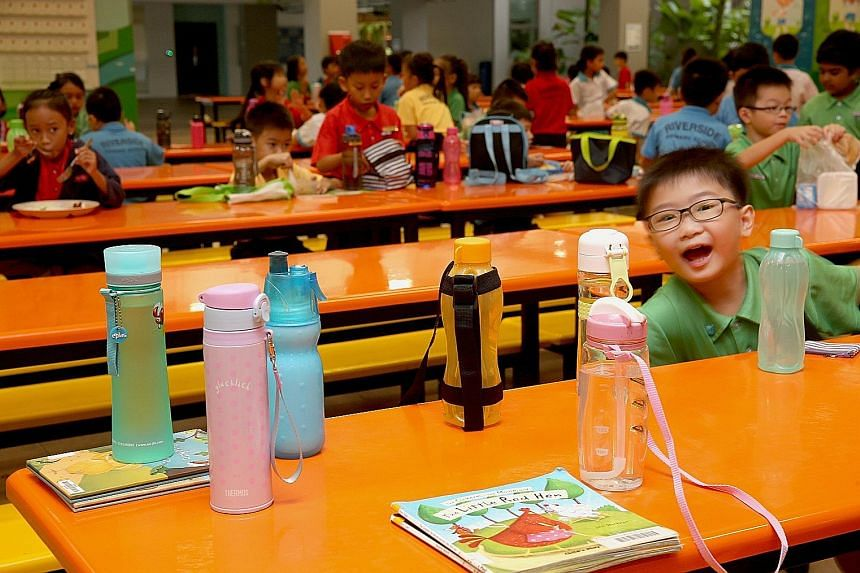 Pupils at Riverside Primary School in Woodlands Crescent are encouraged to bring their water bottles every day and to refill them at the water coolers, says principal Sharon Siew. The school, which started in 2013, has never had a drinks stall.