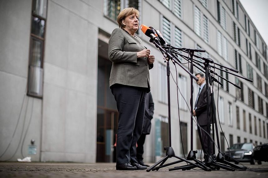 German Chancellor Angela Merkel is under pressure from her own conservative bloc not to compromise too much to secure a coalition deal - in particular on the touchstone topic of immigration.
