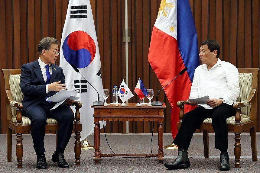 South Korean President Moon Jae In (far left) with Philippine President Rodrigo Duterte, when they met on the sidelines of the Asean summit in Manila on Monday.