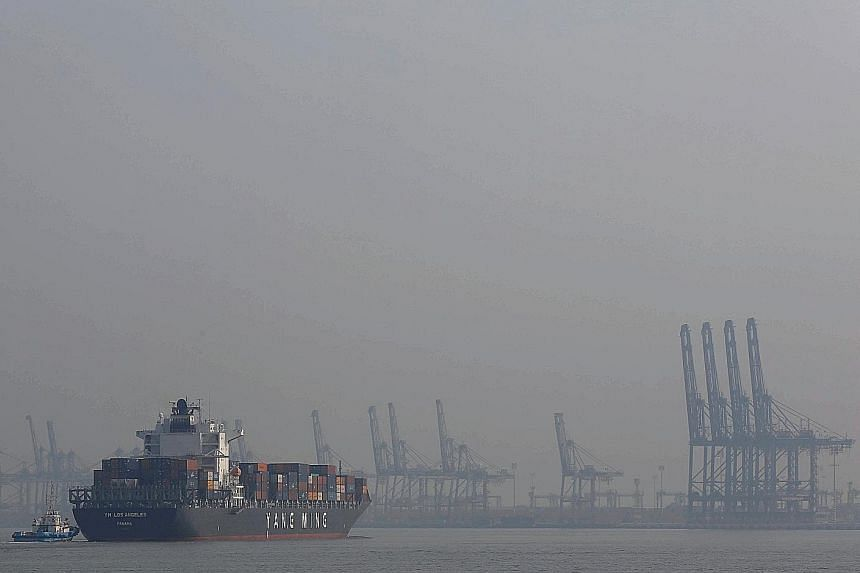 Port Klang (above) has faced a challenging year as new shipping alliances have been moving their scheduled dockings to call at PSA Singapore since April.