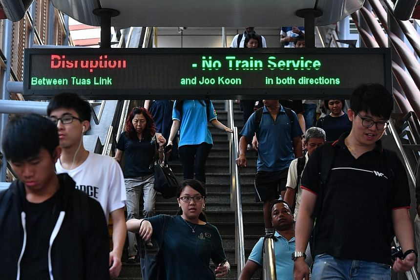 People walking towards the bus stop at Joo Koon station yesterday morning to continue their journey. Most commuters said they were able to switch to buses without a hitch.