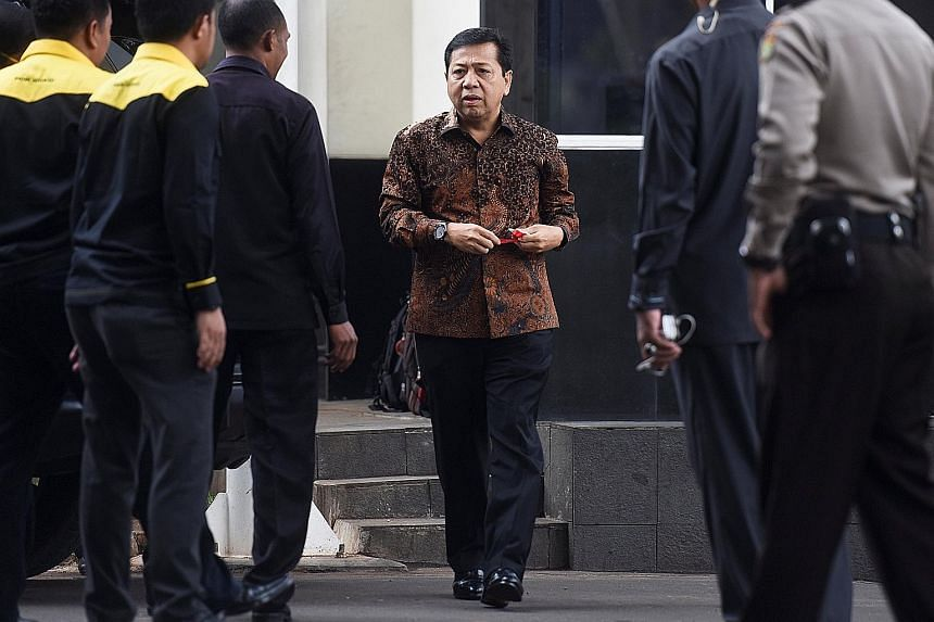 Above: Indonesian politician Setya Novanto arriving at the anti-graft agency KPK's building in Jakarta in July. Below: Police and investigators from KPK searched Mr Novanto's home on Wednesday.