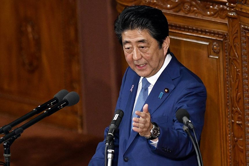 Japanese Prime Minister Shinzo Abe delivers a policy speech at the lower house of the Parliament in Tokyo.