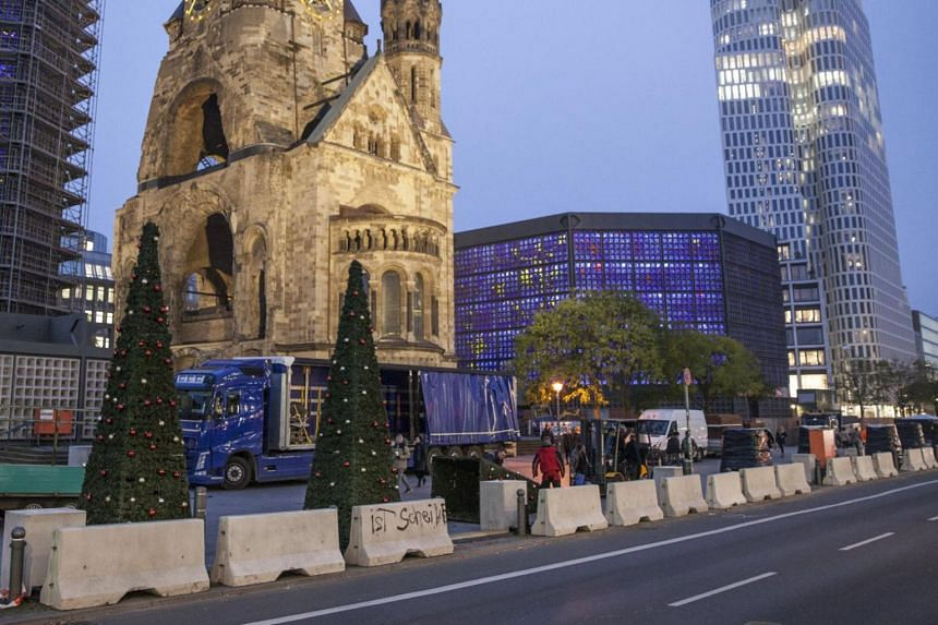 Concrete barriers were placed as a security measure around Breitscheidplatz square in preparations for the Christmas market that will take place later this month, at the central 'Mitte' district in Berlin, Germany, on Nov 9, 2017.